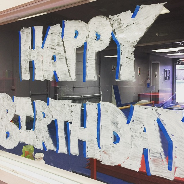 Happy Birthday written in paint on a window