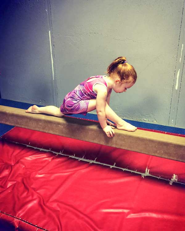 Young girl on balance beam