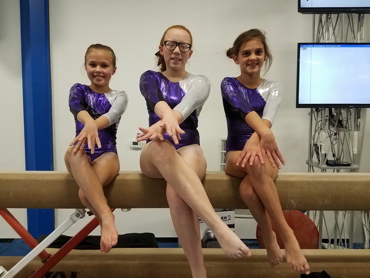 Gymnasts sitting on balance beam